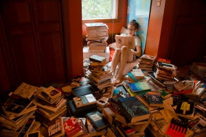 Girl-buried-in-books